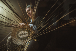 Traditional crafts. Portrait of the Basket Weaver