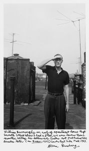 "William Burroughs on roof of apartment house East Seventh Street where I had a flat, we were lovers those months, editing his letters into books not published till decades later (as ""Queer"", 1985.) Lower East Side Fall 1953. © Allen Ginsberg"