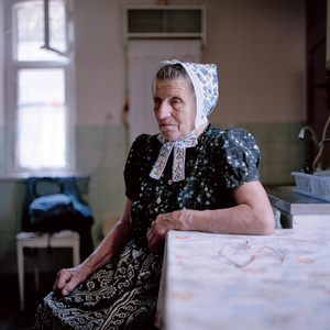 Emma Krahl (b. 1931) in her  Sunday dress for church, Schleife Area, Lusatia, Germany 2010. From the series: Village Queens. The last women in their traditional peasant garbs