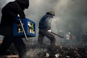 Protesters with a box of Molotov`s cocktails are moving to the frontline (Ukraine, Kiev, February, 2014)