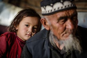A young Kyrgyz girl seeking safety with her grandfather