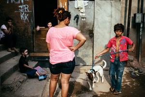 Neighbors in a slum in the surroundings of the Arena Itaquera