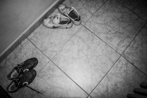 Left trainers in the corridor during a relaxing session