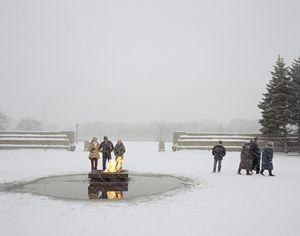 Friends keep warm by the eternal flame. St Petersburg. Northwestern Region, December 2004 From the book, Motherland, by Simon Roberts © Simon Roberts