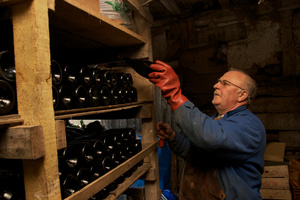 Placing the bottles on a shelf to mature for a few months