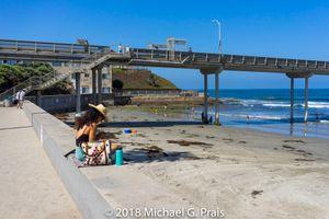 Woman Beach and Fishing Pier