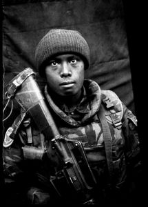 """KABUL PORTRAITS. """"Private first class Robert, telephonist"""". Portraits of Dutch ISAF troops in Kabul, Afghanistan. The photos are taken with the antique box camera, borrowed from an Afghan street photographer in Kabul. The exposure time of each photo was 10 seconds."""