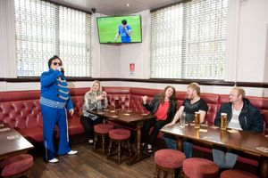 An Elvis Impersonator performs in a pub in Hull, 2016