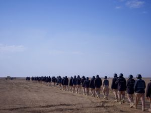 Afghan police trainees being taken to the firing ranges by US Marines, Camp Leatherneck, Helmand. © Simon Norfolk.