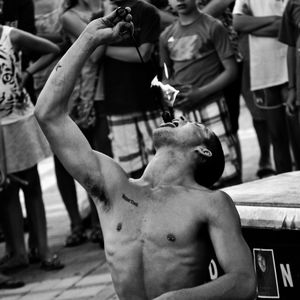 Street Performer Reid Fierheller-Conklin Swallowing Fire, Key West, Florida