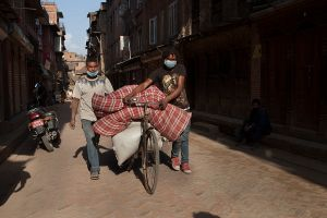 People are leaving after collecting their households from the rubbles in Bhaktapur, Nepal.