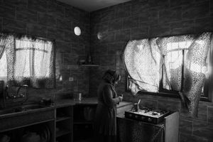 Azmi Qudiah's wife is seen making coffee in their damaged home in Khuza'a, Khan Younis, southern Gaza, on Nov. 2nd 2014.