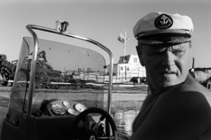 Anatoly. Local businessman. In his free time he likes to go fishing with his Finnish speed boat. Kargasok. Tomsk region. Russia. 2008.