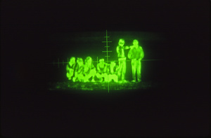Undocumented Mexican immigrants caught in a Border Patrol night scope.
