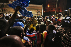 The audience and press storm the arena after the final fight to celebrate the winner, as here in the Iba Mar Diop stadium in Dakar, March 29, 2015. The winner can count himself happy; nevertheless, he has just won prize money worth 12,000 dollars - in Senegal a lot of money.
