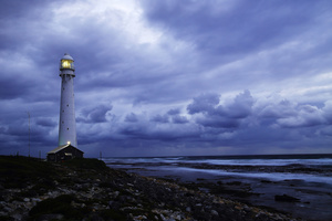 Seascape with storm / The Slangkop lighthouse is the tallest lighthouse on steel tower in South Africa. It is located on the Atlantic Ocean, close to the southern tip of the Cape Peninsula, the Cape of Good Hope. A place of gale force winds and sudden storms throughout the year.