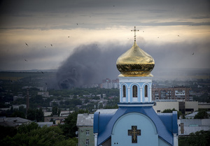 A smoke in the city of Luhansk during an artillery attack