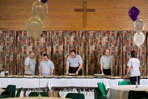 Left to right: Pasquale, Nicholas, Paul, Peter, and Tracey serving food at an event. MacIntyre Catering, Milton Keynes