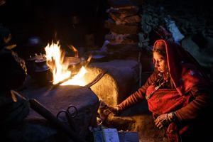 A wakhi nomad woman is cooking in a nomad shelter in one of the valleys of the little Pamir.