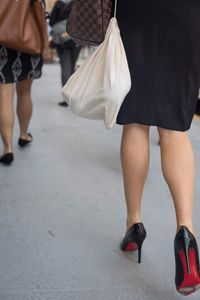 Lady in High Heels with Two Bags