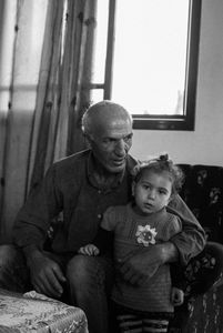 Khalil Zaanin is seen with his nephew Meera in his home in Beit Hanoun, northern Gaza, on Oct. 28th 2014.