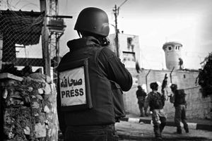 Local Press report on the clashes appropriately equipped with ballistic protective equipment and in some cases gas masks. © Will Hilton