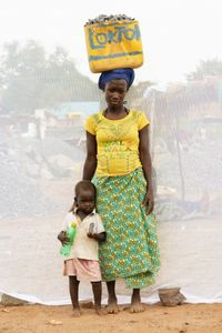 A. Catherine with her daughter Jessica: Works in quarry breaking stones to make gravel.  Earns 1,000 shillings ($0.32) per Jerrycan of gravel. Makes 10 to 13 Jerrycans of gravel per day.