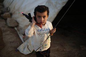 Syrian refugee boy in an informal tented settlement in Jordan.