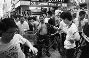 Phone Fight © Steve Bromberg, China