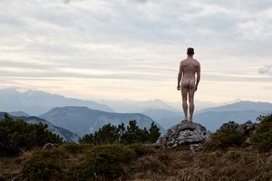 The naked man at the top of a mountain above the Salzkammergut