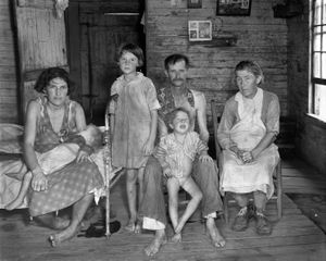 """Sharecropper Bud Fields and his family at home. Photo from """"Let Us Now Praise Famous Men."""" © Walker Evans. Published by Houghton Mifflin Company"""