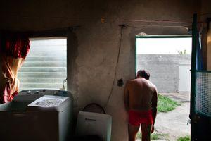 Gerardo staring out from his door. © Meeri Koutaniemi