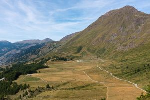 The old military roadStrada dell'Assietta, Piemonte, Italy, snakes upward toward the horizon, commencing its 60km path, almost all above 2,000m following the ridge separating the Susa and Chisone valleys, to Sestriere