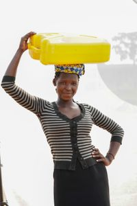 A. Daphine: Carries 5 gallon jerrycan 4 to 5 times a day for family use.