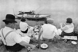 """Sunday on the Banks of the Marne. From """"The Decisive Moment."""" © Henri Cartier-Bresson / Magnum. Published  by Simon and Schuster in the US and Editions Verve in France. Most recently reprinted by Steidl."""