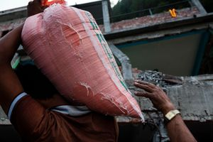 Villagers pull out rice sacks from rubble, Sigati, Dalakha district.