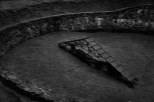 Pit used to burn corpses that were exhumed to destroy evidence of mass murders