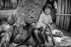 Mayan kid with his monkey
