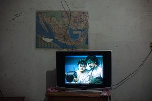 Scene of La Misma Luna, a Mexican movie that talks about migration. Migrants gather in this room to watch movies or TV shows in the Casa del Migrante in Arriaga, Mexico, April 20, 2013.