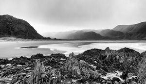 Rocks Sandshore and mountains Sandfjord Varanger Norway