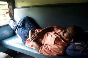 Sleeping Man on Train