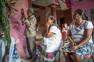 Don Mario Kahuil reads prayers in Latin, Spanish and Maya.