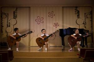 Children perform at the Pyongyang Kyongsang Kindergarten in Pyongyang,North Korea, 20 May 2015.