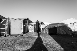 Selima, volunteer, Family on a Mission watching over the tents