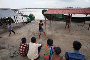 Children are playing cricket in Shyamnagar, Satkhira, Bangladesh