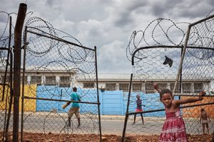 """Children play in a street in Damara 6, a quarter of the township Katutura. In the Herero language the word Katutura means """"The place where people do not want to live""""."""