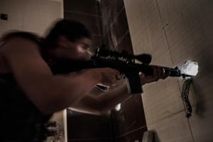 A FSA sniper shooting to Syrian loyalist army positions, in Karm Al-Jabal.