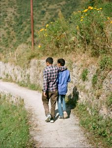 After a two hour trek we arrived in Sanjay's village in the foothills of the Himalayas, He was greeted by his neighbor.  Uttarakhand, 2017