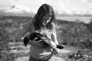 Girl with dead black grouse