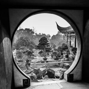 Garden beyond round gateway